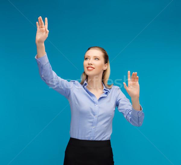 женщину рабочих что-то мнимый ярко фотография Сток-фото © dolgachov