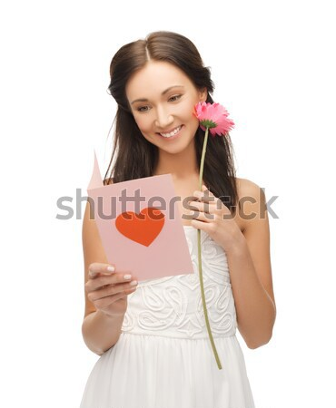 young woman holding flower and  postcard Stock photo © dolgachov