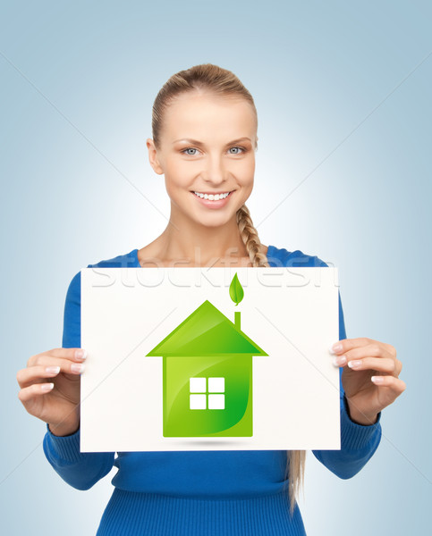 woman with illustration of green eco house Stock photo © dolgachov