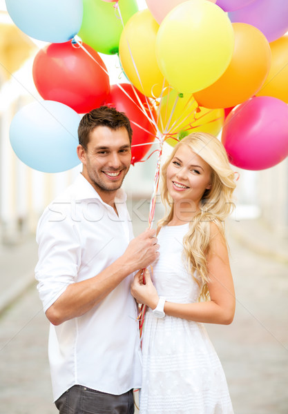 couple with colorful balloons Stock photo © dolgachov