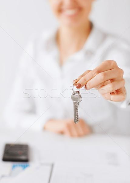 woman hand holding house keys Stock photo © dolgachov