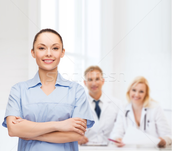 smiling female doctor or nurse Stock photo © dolgachov
