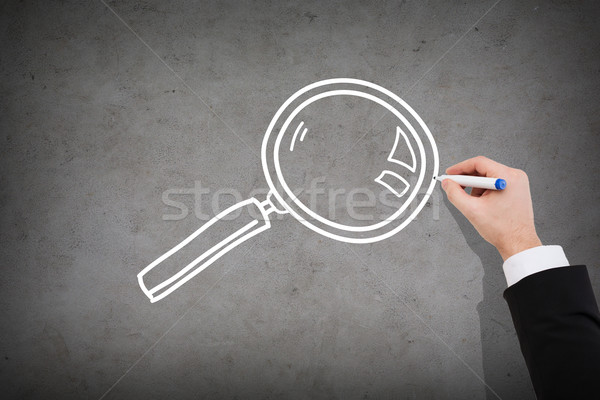 close up of businessman drawing magnifying glass Stock photo © dolgachov
