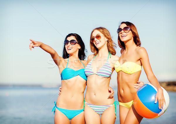 girls with ball on the beach Stock photo © dolgachov