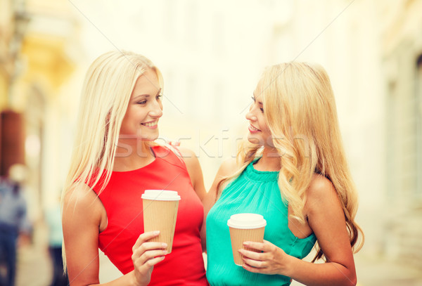 two women with takeaway coffee cups in the city Stock photo © dolgachov