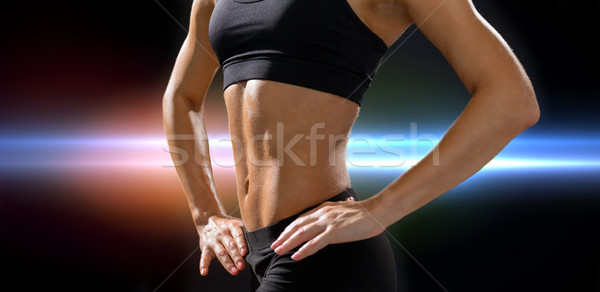 close up of athletic female abs in sportswear Stock photo © dolgachov