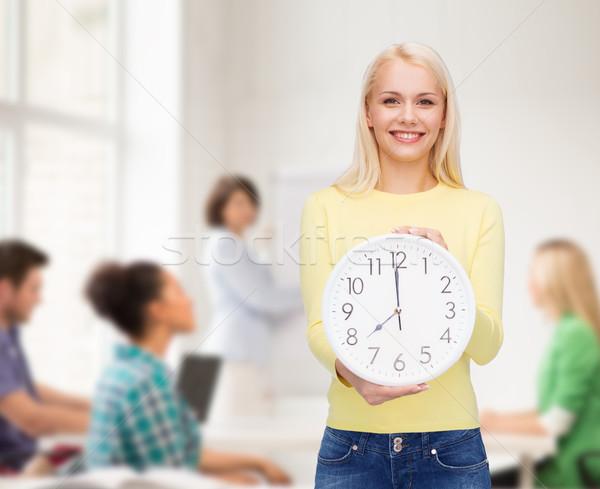 Estudante parede relógio tempo educação pessoas Foto stock © dolgachov