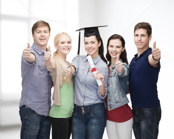 group of students with diploma showing thumbs up Stock photo © dolgachov