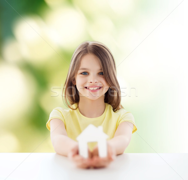 beautiful little girl holding paper house cutout Stock photo © dolgachov