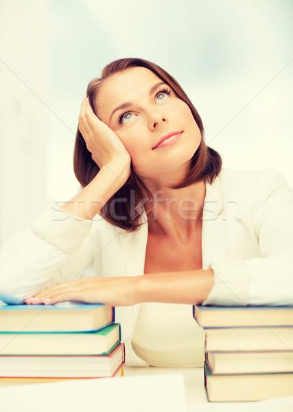 Unatkozik fiatal nő sok könyvek bent oktatás Stock fotó © dolgachov