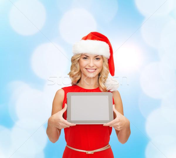 Nő mikulás segítő kalap táblagép karácsony Stock fotó © dolgachov