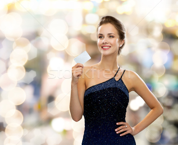 Sorrindo vestido de noite cartão de crédito compras riqueza Foto stock © dolgachov