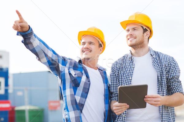 Stock fotó: Mosolyog · építők · táblagép · üzlet · épület · csapatmunka