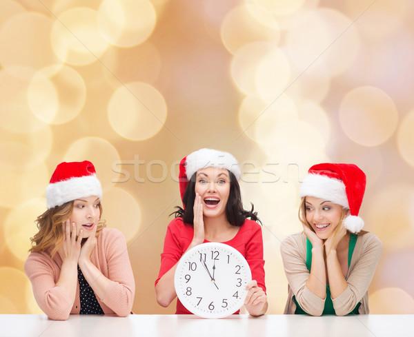 smiling women in santa helper hat with clock Stock photo © dolgachov