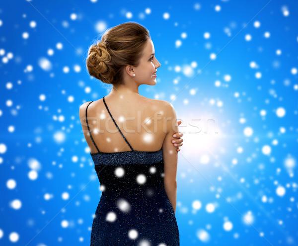 Sorrindo vestido de noite pessoas férias natal azul Foto stock © dolgachov