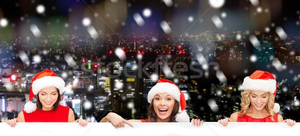 Nők mikulás segítő kalap fehér tábla karácsony Stock fotó © dolgachov