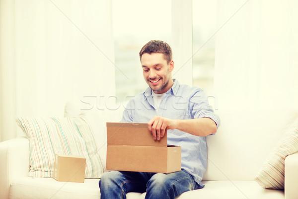Man karton dozen home post lifestyle Stockfoto © dolgachov