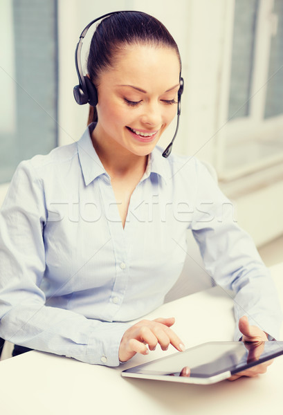 friendly female helpline operator with tablet pc Stock photo © dolgachov