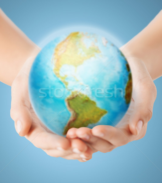 close up of human hands with earth globe Stock photo © dolgachov