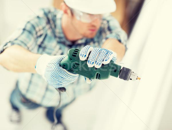 man drilling the wall Stock photo © dolgachov