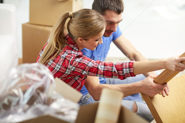 close up of couple unpacking furniture and moving Stock photo © dolgachov