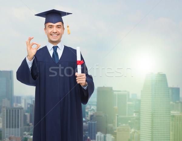 улыбаясь взрослый студент диплом образование окончания Сток-фото © dolgachov