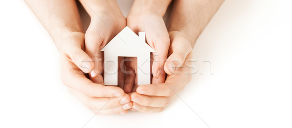 man and woman hands with white paper house Stock photo © dolgachov