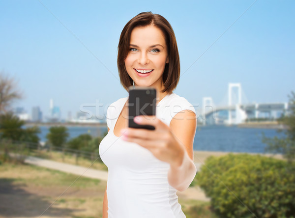 woman taking selfie with smartphone over tokyo Stock photo © dolgachov