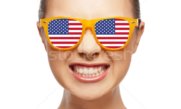angry teenage girl in glasses with american flag Stock photo © dolgachov
