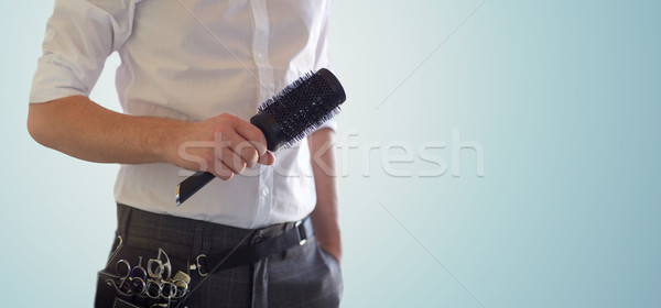 close up of male stylist with brush at salon Stock photo © dolgachov