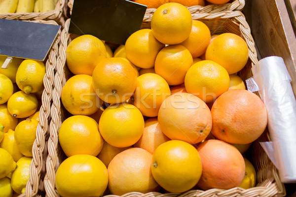 ripe grapefruits at food market Stock photo © dolgachov