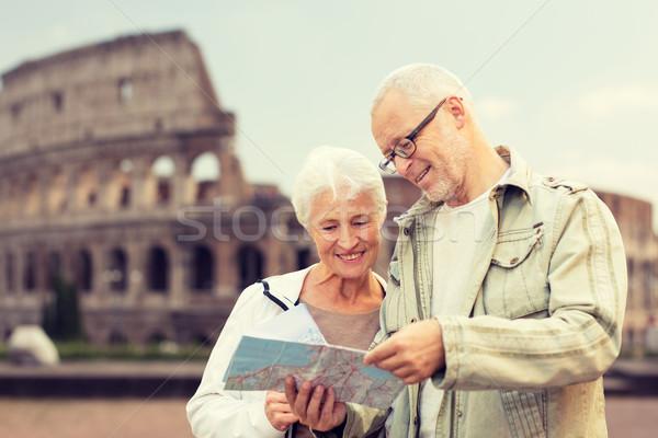 senior couple on city street Stock photo © dolgachov