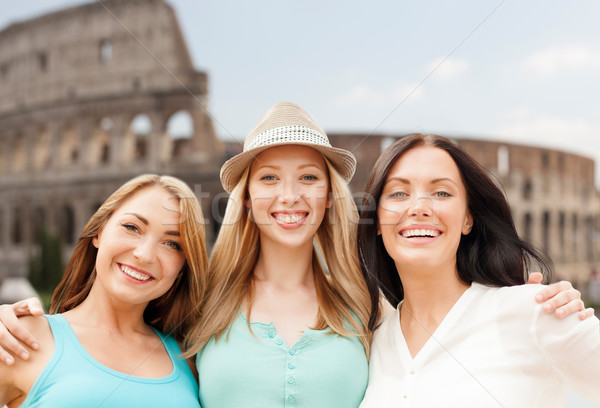 group of happy young women over coliseum Stock photo © dolgachov