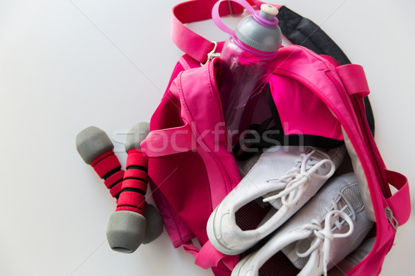 close up of female sports stuff in backpack Stock photo © dolgachov