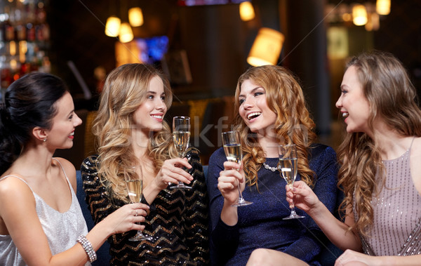 Feliz mujeres champán gafas club nocturno celebración Foto stock © dolgachov