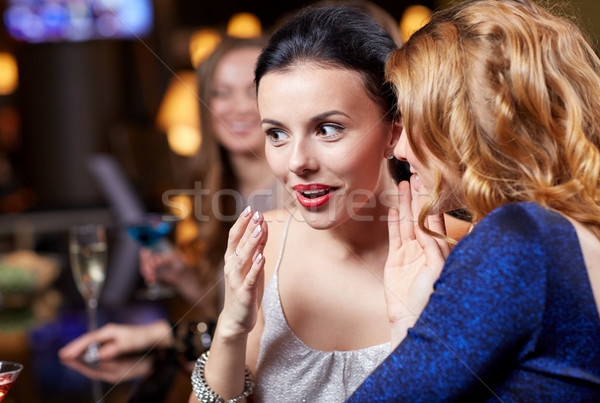 happy women with drinks at night club Stock photo © dolgachov