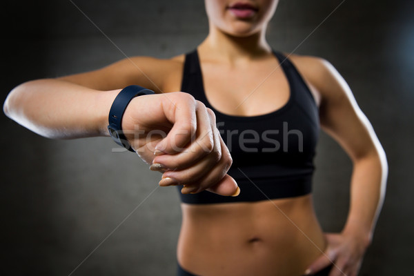 woman with heart-rate watch in gym Stock photo © dolgachov