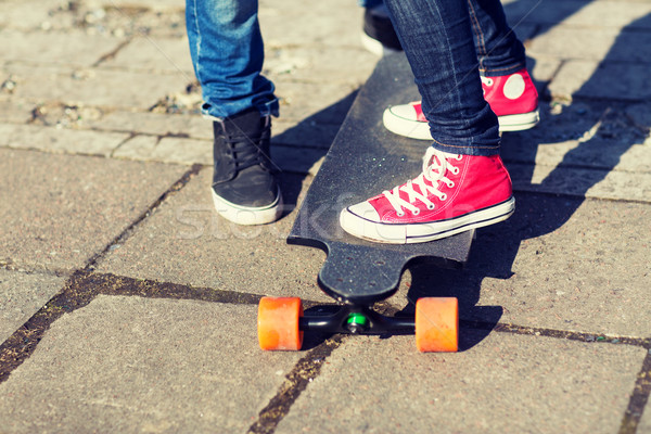 close up of couple with longboard on street Stock photo © dolgachov