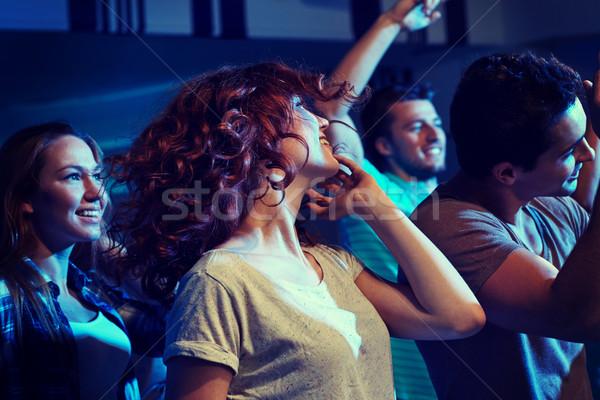 Gelukkig vrienden dansen nachtclub partij vakantie Stockfoto © dolgachov