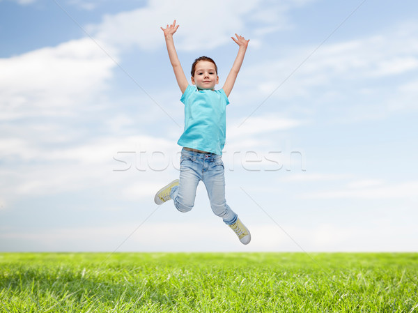 Gelukkig meisje springen lucht geluk jeugd Stockfoto © dolgachov