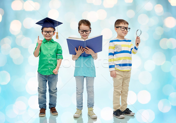 kids in glasses with book, lense and bachelor hat Stock photo © dolgachov