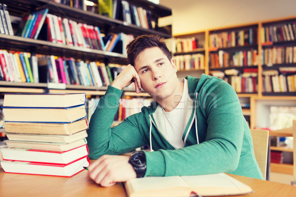 bored student or young man with books in library Stock photo © dolgachov