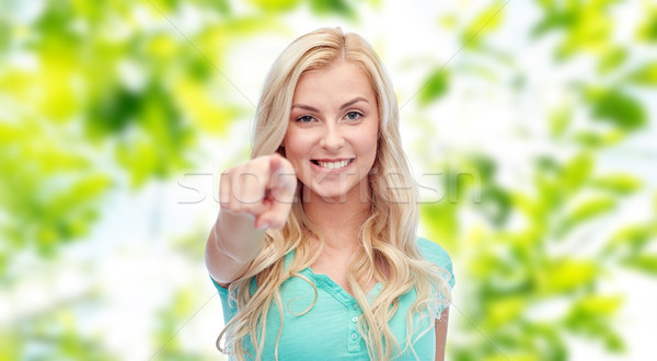 happy young woman pointing finger to you Stock photo © dolgachov