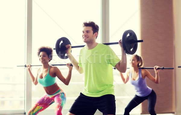 группа людей штанга спортзал фитнес спорт Сток-фото © dolgachov