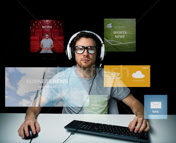 man in headset computer over virtual media screens Stock photo © dolgachov