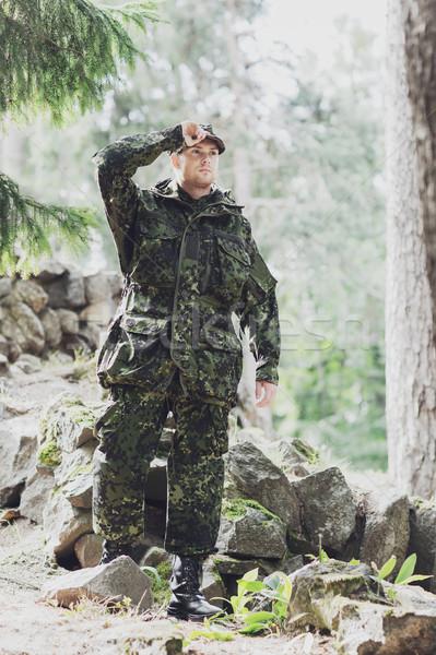 Giovani soldato foresta guerra esercito persone Foto d'archivio © dolgachov
