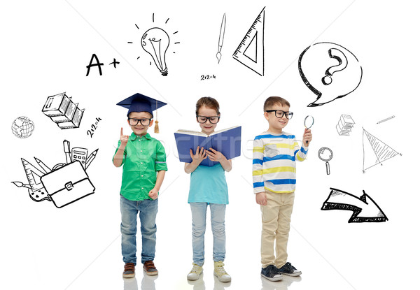 kids in glasses with book, lens and bachelor hat Stock photo © dolgachov