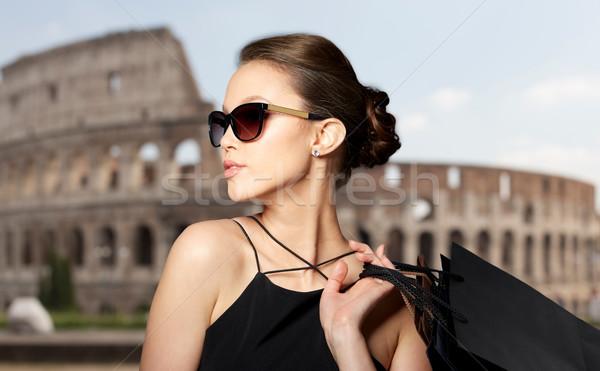счастливым женщину черный Солнцезащитные очки продажи Сток-фото © dolgachov