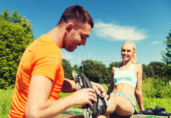 happy couple with rollerblades outdoors Stock photo © dolgachov