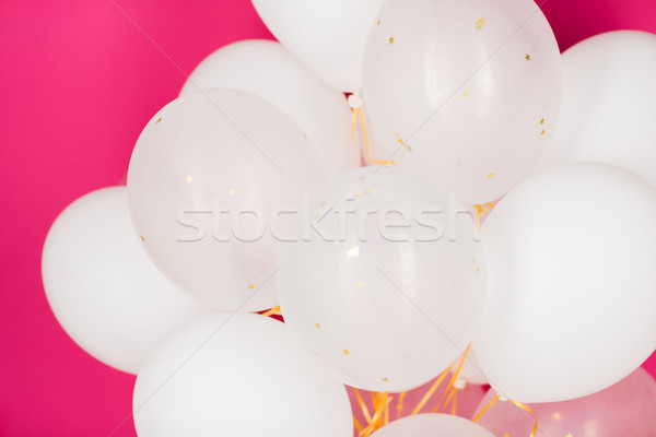 Witte helium ballonnen roze vakantie Stockfoto © dolgachov